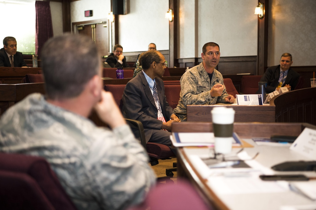 Col. Louis Orndorff, deputy director of contracting, Air Force Life Cycle Management Center, Hanscom Air Force Base, Mass., discusses acquisition strategies with David Temple, program management organizational staff functional with the Battle Management Directorate at Hanscom and Maj. Gen Dwyer Dennis, Air Force Acquisition Executive Program Executive Officer of Command, Control, Communication, Information and Networks June 30, 2017 at the Hanscom Conference Center. The senior acquisition personnel attended presentations by teams assigned to participate in the Air Force Office of Transformational Innovation's pilot acquisition wargame, held June 26-30, 2017, at Hanscom. (U.S. Air Force photo by Benjamin Newell)