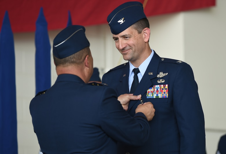 U.S. Air Force Col. Stephen Hodge, right, 317th Airlift Group commander, is awarded the Legion of Merit by Lt. Gen. Giovanni Tuck, 18th Air Force commander, at Dyess Air Force Base, Texas, July 6, 2017. The Legion of Merit is awarded for exceptionally meritorious conduct in performance of outstanding services. The performance recognizes key individuals for service rendered in a clearly exceptional manner. (U.S. Air Force photo by Airman 1st Class Emily Copeland)