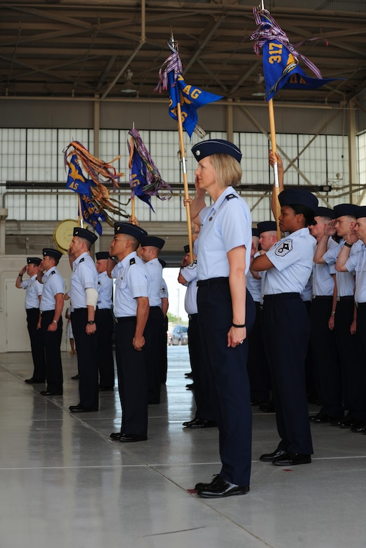 U.S. Air Force Airmen from the 317th Airlift Wing render a salute during the 317th AW activation ceremony at Dyess Air Force Base, Texas, July 6, 2017. The 317th AW supports the Department of Defense, Joint Chiefs of Staff and higher headquarter taskings, and reports to the 18th Air Force at Scott AFB, Ill. (U.S. Air Force photo by Airman 1st Class April Lancto)