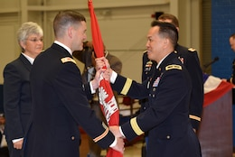 Brig. Gen. Mark Toy (Right), U.S. Army Corps of Engineers Great Lakes and Ohio River Division commander, passes the Corps of Engineers flag to Lt. Col. Cullen A. Jones as he took command of the Nashville District during a change of command ceremony July 7, 2017 at the Tennessee National Guard Armory in Nashville, Tenn.