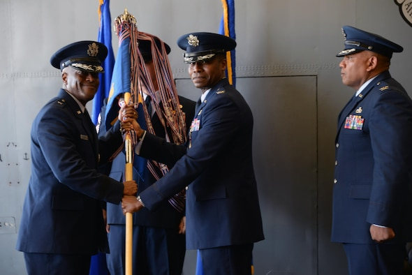 Col. Jason Childs hands off the guidon to Brig. Gen. Ronald E. Jolly Sr. during the 982nd Change of Command ceremony July 7, 2017. Col. Childs passed on command of the 982nd TRG to Col. Anthony Puente. (U.S. Air Force photo by Senior Airman Robert L. McIlrath)