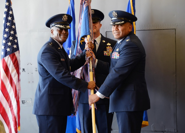 Brig. Gen. Ronald E. Jolly Sr., 82nd Training Wing commander, passes the ceremonial guidon to Col. Anthony Puente, incoming 982nd Training Group commander, during the 982nd TRG Change of Command ceremony at Sheppard Air Force Base, Texas, July 7, 2017.