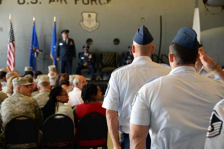 Members of the 982nd Training Group render their first salute to their new commander, Col. Anthony Puente, during a Change of Command ceremony July 7, 2017. (U.S. Air Force photo by Robert L. McIlrath)