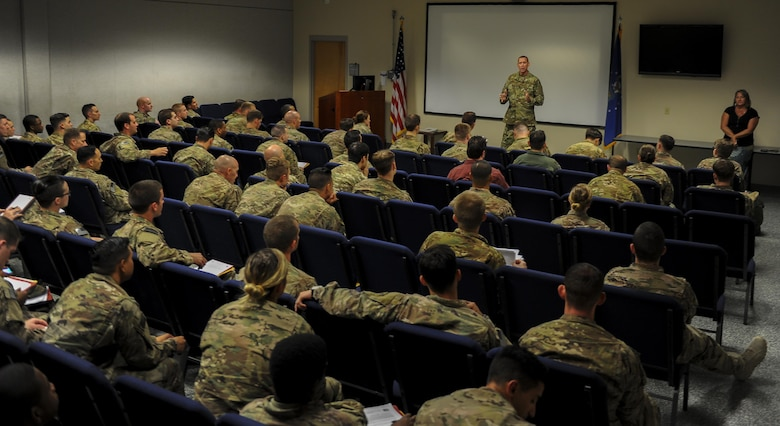 Air Commandos returning from deployment receive a reintegration briefing at the deployment control center, Hurlburt Field, Fla., July 6, 2017. Reintegration briefings ensure Air Commandos are aware of the various resources available to them when they come return home. The chapel, Military Family Life Counselor, Preservation of the Force and Family, financial, and medical services help Airmen remain resilient and ready to execute operations on the home front after deployments. (U.S. Air Force photo by Airman 1st Class Isaac O. Guest IV)