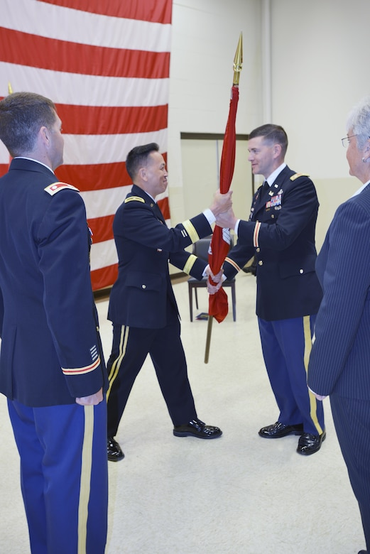 Lt. Col. Cullen A. Jones, incoming commander, receives the unit colors from Brig. Gen. Brig. Gen. Mark Toy, U.S. Army Corps of Engineers Great Lakes and Ohio River Division commander, during the change of command ceremony at the Tennessee National Guard Armory in Nashville, Tenn. July 7, 2017. Looking on is Nashville District Deputy District Engineer for Program Management Patty Coffey (far right), and outgoing commander, Lt. Col. Stephen F. Murphy (far left).