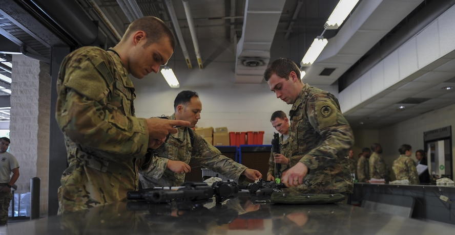 Air Commandos clean their weapon during post-deployment in-processing at the deployment control center, Hurlburt Field, Fla., July 6, 2017. Air Commandos clean weapons for a final time before returning them to the 1st Special Operations Squadron Combat Arms Training and Maintenance. Incorporating feedback from Air Commandos, the DCC added CATM in October 2016 to alleviate the need to make an additional stop after reintegration. (U.S. Air Force photo by Airman 1st Class Isaac O. Guest IV)