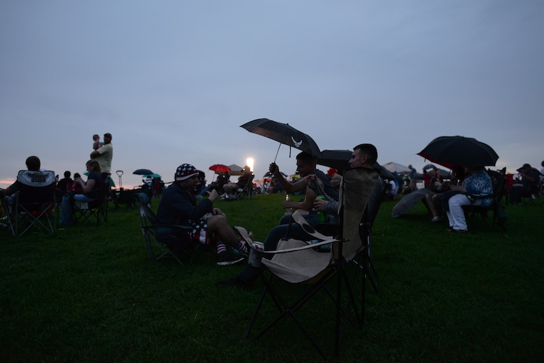 Family and friends gather as the sun sets during Fireworks on the Water July 1, 2017, at the Stennis Lock and Dam in Columbus, Mississippi. People stayed entertained by the bouncy obstacle courses, tossing footballs, talking with friends or vendors and dancing to music being played from the stage's pre-made playlist.