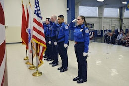 The Nashville Airport TSA Honor Guard salutes the colors during the change of command ceremony at the Tennessee National Guard Armory in Nashville, Tenn. July 7, 2017.