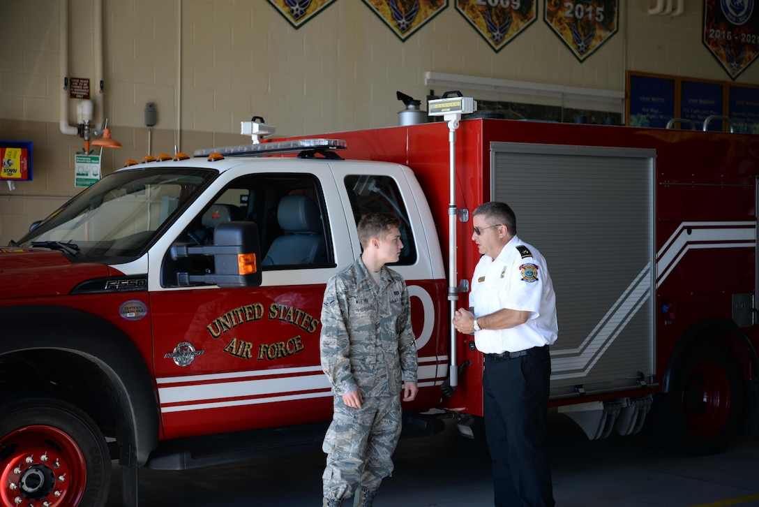 Airman Justin Weeter, 14th Civil Engineer Squadron firefighter, and Peter Delillo, 14th CES Fire Prevention Inspector, talk inside the Columbus Air Force Base, Mississippi, Fire Station June 29, 2017. The Fire Protectors have many different ways to bring information to the Airmen and families on base through community events and different courses mandatory to newly arriving base members. (U.S. Air Force photo by Airman 1st Class Keith Holcomb)