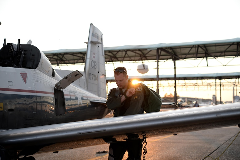 Capt. Roland Neal, 37th Flying Training Squadron Instructor Pilot, grabs his gear after a flight June 28, 2017, on Columbus Air Force Base, Mississippi. The instructor pilots ride with student pilots unless the student is taking a solo flight. (U.S. Air Force photo by Airman 1st Class Keith Holcomb)