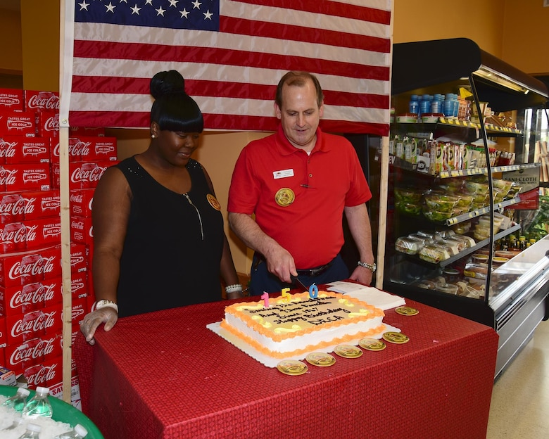 Tanesha Hill, Columbus Air Force Base Commissary Interim Secretary, and Greg Runyon, Columbus AFB Commissary Assistant Store Director, cut a cake at the Columbus AFB Commissary June 30, 2017, on Columbus AFB, Mississippi. The event was in recognition of the Defense Commissary Agency's 150 years of service to the Armed Forces. (U.S. Air Force photo by Elizabeth Owens)