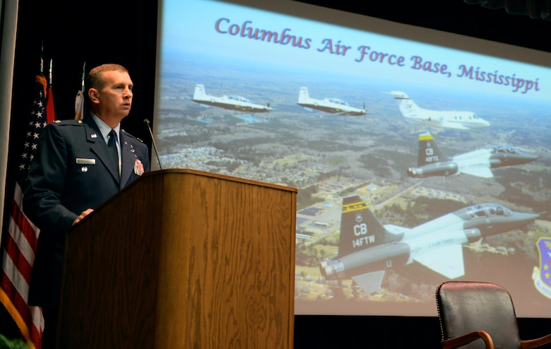 Col. James Fisher, 14th Flying Training Wing Vice Commander, speaks at the graduation of Specialized Undergraduate Pilot Training Class 17-11 June 30, 2017, at Columbus Air Force Base, Mississippi. Fisher himself graduated from the pilot training program at Columbus AFB in 1997 in SUPT Class 97-04. (U.S. Air Force photo by Airman 1st Class Keith Holcomb)