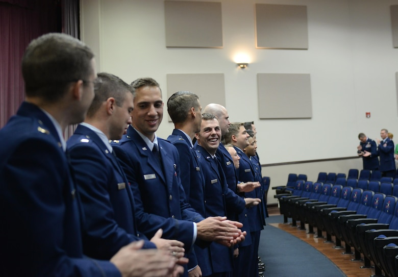 Specialized Undergraduate Pilot Training Class 17-11 celebrates after earning their wings on Columbus Air Force Base, Mississippi, June 30, 2017. Twenty-four officers graduated with SUPT Class 17-11. (U.S. Air Force photo by Airman 1st Class Keith Holcomb)