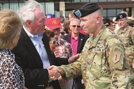 Brig. Gen. Patrick D. Frank, 1st Infantry Division and Fort Riley acting senior commander, shakes hands with retired Lt. Gen. Mike Dodson, Manhattan, Kansas, city commissioner during a Victory with Honors ceremony June 27 at the division's headquarters. Frank, who initially served as the deputy commanding general, took on the responsibility of the acting senior commander in October 2016 when the division headquarters deployed. He will go on to serve as the deputy commanding general of the Army Cadet Command at Fort Knox, Kentucky.
