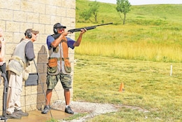 Greg Clasberry, son of Ron Clasberry, deputy safety manager for Fort Riley Garrison Safety Office, prepares to shoot a clay pigeon during the advanced trap and skeet camp June 29 at Fort Riley.