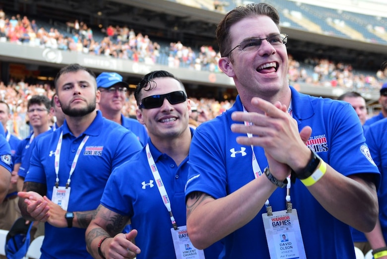 Air Force Staff Sgt. David Olson, an explosive ordnance disposal troop from Abilene, TX, cheers enthusiastically as the Air Force is introduced at the 2017 Department of Defense Warrior Games opening ceremony July 1, 2017, at Soldier Field, Chicago, Ill. While it has been a short seven-month journey for Olson toward recovery, he recalls how dark of a place he was previously in compared to now, noting the measurable distance he is today from who he was then. (U.S. Air Force photo/Staff Sgt. Alexx Pons)