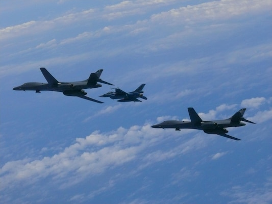 Two U.S. Air Force B-1B Lancers assigned to 9th Expeditionary Bomb Squadron, deployed from Dyess Air Force Base, Texas, fly with Koku Jieitai F-2 fighter jet over East China Sea, July 7, 2017