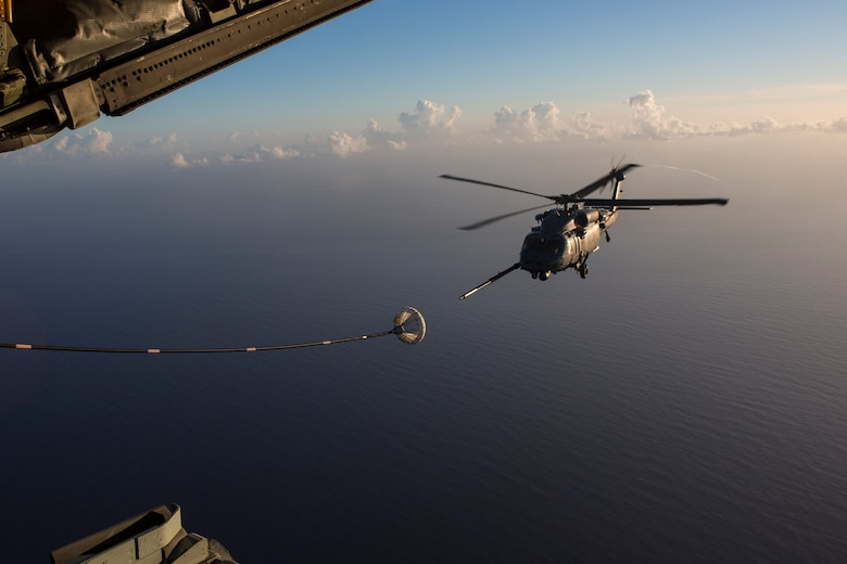 An HH-60G Pave Hawk refuels from an HC-130P/N King enroute to rescue two German citizens in distress at sea July 7, 2017 and into July 8. The victim's vessel caught fire approximately 500 nautical miles off the east coast of southern Florida. At the request of the U.S. Coast Guard's Seventh District in Miami, the 920th RQW was alerted by the Air Force Rescue Coordination Center at Tyndall Air Force Base, Florida, to assist in the long-range search and rescue. Approximately 80 wing Citizen Airmen and four wing aircraft helped execute the rescue mission to include, maintenance, operations and support personnel. (U.S. Air Force photo by Master Sgt. Mark Borosch)