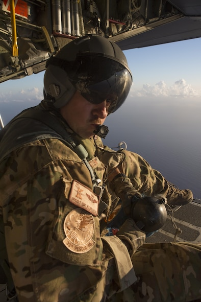 """Master Sgt. Bob Kurzen, HC-130P/N """"King"""" loadmaster is part of  concerted rescue effort of approximately 80 wing personnel from the 920th Rescue Wing who rescued two German citizens in distress at sea July 7, 2017 and into July 8. The victim's vessel caught fire approximately 500 nautical miles off the east coast of southern Florida. At the request of the U.S. Coast Guard's Seventh District in Miami, the 920th RQW was alerted by the Air Force Rescue Coordination Center at Tyndall Air Force Base, Florida, to assist in the long-range search and rescue. Approximately 80 wing Citizen Airmen and four wing aircraft helped execute the rescue mission to include, maintenance, operations and support personnel. (U.S. Air Force photo by Master Sgt. Mark Borosch)"""
