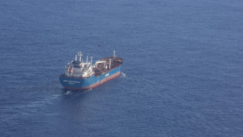 The Nord Nightingale, a container ship from Singapore, assisted in a concerted rescue effort with the 920th Rescue Wing of two German citizens in distress at sea July 7, 2017. The victim's vessel caught fire approximately 500 nautical miles off the east coast of southern Florida. At the request of the U.S. Coast Guard's Seventh District in Miami, the 920th RQW was alerted by the Air Force Rescue Coordination Center at Tyndall Air Force Base, Florida, to assist in the long-range search and rescue. Approximately 80 wing Citizen Airmen and four wing aircraft helped execute the rescue mission to include, maintenance, operations and support personnel. (U.S. Air Force photo by Master Sgt. Mark Borosch)