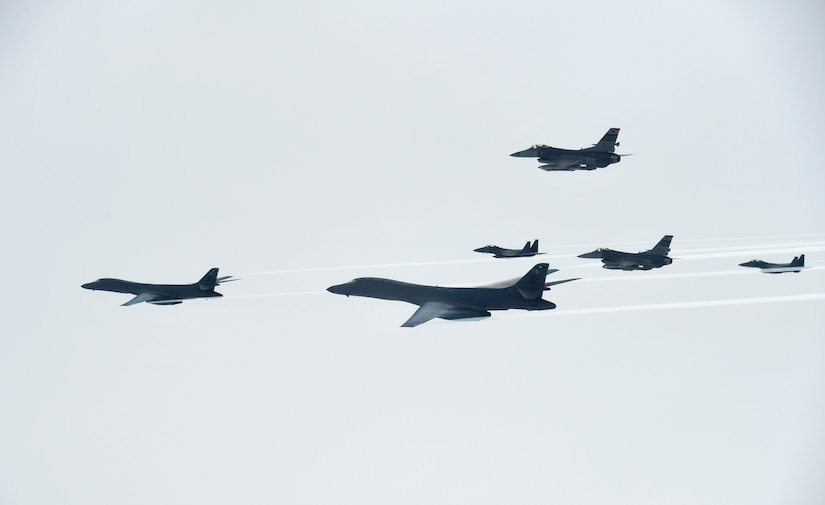 U.S. Air Force B-1B Lancers assigned to the 9th Expeditionary Bomb Squadron, deployed from Dyess Air Force Base, Texas, fly with South Korean F-15 and U.S. Air Force F-16 fighter jets over the Korean Peninsula, July 7, 2017. The Lancers departed Andersen Air Force Base, Guam, to conduct a sequenced bilateral mission with South Korean F-15s and Japan Air Self-Defense Force F-2 fighter jets. Photo courtesy of the South Korean air force