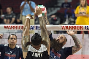 Navy veteran Seaman Steven Davis attempts a spike during the sitting volleyball gold medal round of the 2017 Department of Defense Warrior Games at the United Center, Chicago, July 7, 2017. DoD photo by EJ Hersom