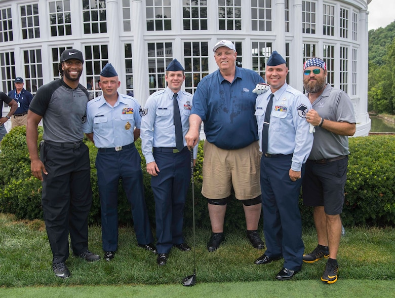Arizona Cardinals wide receiver Larry Fitzgerald (l to r), Master Sgt. Kevin Cordle, Staff Sgt. Adam King, West Virginia Governor Jim Justice, Master Sgt. Scott Melton, and Duck Dynasty Star Willie Roberson pose for a photo prior to teeing off at the 2017 PGA Greenbrier Classic Pro Am held July 5, 2017, on The Old White TPC at The Greenbrier, White Sulphur Springs, W.Va. Cordle, King and Melton are members of the 130th Airlift Wing, McLaughlin Air National Guard Base, Charleston, W.Va. (U.S. Air National Guard photo by Tech. Sgt. De-Juan Haley)