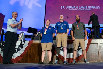 Air Force Gen. Paul J. Selva, vice chairman of the Joint Chiefs of Staff, applauds Ultimate Champion Medal recipients, from left, Air Force Senior Airman Jamie Biviano, gold, Air Force Capt. Austin Williamson, silver, and Marine Corps Staff. Sgt. John Stanz, bronze, during the 2017 Department of Defense Warrior Games in Chicago, July 8, 2017. DoD photo by EJ Hersom