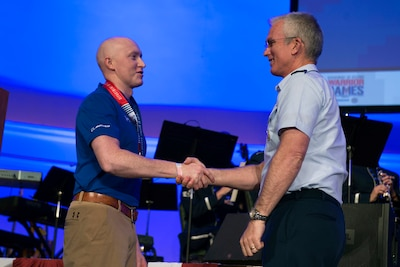 Air Force Gen. Paul J. Selva, vice chairman of the Join Chiefs of Staff, congratulates Air Force Capt. Austin Williamson for winning an Ultimate Champion Medal in the 2017 Department of Defense Warrior Games in Chicago, July 8, 2017. DoD photo by EJ Hersom