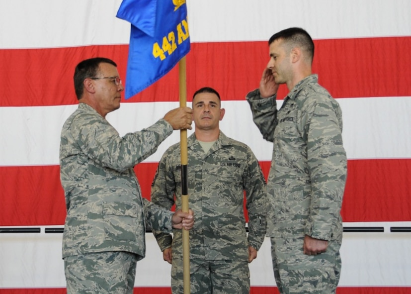 Col. James Brock, 442d Fighter Wing Maintenance Group commander, passes the guidon to Maj. James Chevalier, incoming 442d Aircraft Maintenance Squadron commander, during an assumption of command ceremony at Whiteman Air Force Base, Mo., July 8, 2017. Chevalier's previous assignment was the Implementation Branch Chief, Repair Network Integration Division, Headquarters Air Force Material Command, Wright-Patterson AFB, Oh. (U.S. Air Force photo by Senior Airman Missy Sterling)