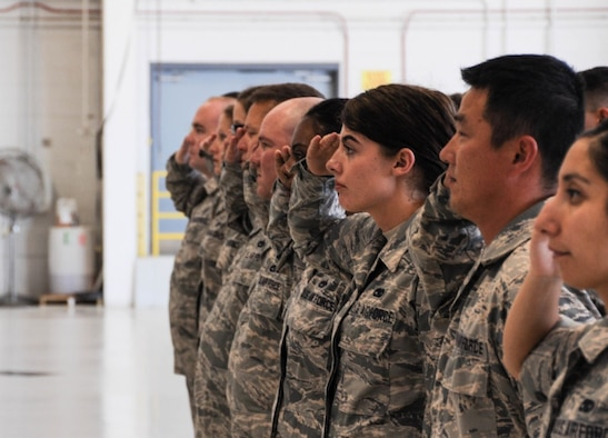 Airmen from the 442d Aircraft Maintenance Squadron salute their new commander during an assumption of command ceremony at Whiteman Air Force Base, Mo., July 8, 2017. More than 200 reserve and active duty airmen in six different specialties make up the squadron that is responsible for a fleet of 28 A-10C Thunderbolt II aircraft. (U.S. Air Force photo by Senior Airman Missy Sterling)