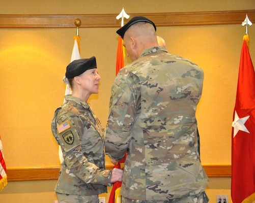 Brig. Gen. Peter B. Andrysiak, Commander of the U.S. Army Corps of Engineers, Pacific Ocean Division, passes the Engineer Colors to Col. Teresa Schlosser, Far East District commander, during a change of command ceremony on U.S. Army Garrison Yongsan, July 7.