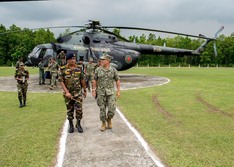 170708-N-WY954-210GAZIPUR, BANGLADESH (July 8, 2017) – Adm. Harry Harris, Commander U.S. Pacific Command (PACOM), is greeted by Commandant of the Bangladesh Institute of Peace Support Operations Training (BIPSOT), Maj. Gen. Enayet Ullah, after arriving by helicopter. This is Harris' first visit to Bangladesh as PACOM commander. During the visit he met with counterparts and government officials for discussions on military cooperation and regional security initiatives in the Indo-Asia Pacific. (U.S. Navy photo by Mass Communications Specialist 2nd Class Robin W. Peak/ Released)