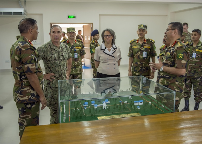 170708-N-WY954-433GAZIPUR, BANGLADESH (July 8, 2017) – Adm. Harry Harris, Commander U.S. Pacific Command (PACOM), center-left, and U.S. Ambassador to Bangladesh Marcia Bernicat, center-right, are given a tour of the Wargame Room at the $3.6 million new multipurpose training facility at the Bangladesh Institute of Peace Support Operations Training (BIPSOT) by BIPSOT Commandant of the, Maj. Gen. Enayet Ullah, right, and Bangladesh Chief of Army Staff Gen. Belal, left. This is Harris' first visit to Bangladesh as PACOM commander. During the visit he met with counterparts and government officials for discussions on military cooperation and regional security initiatives in the Indo-Asia Pacific. (U.S. Navy photo by Mass Communications Specialist 2nd Class Robin W. Peak/ Released)