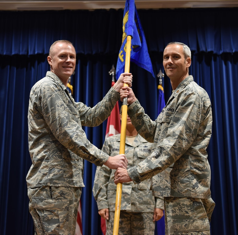 U.S. Air Force Maj. Michael McGrath (right), 39th Force Support Squadron incoming commander, assumes command from Col. Todd Stratton, 39th Mission Support Group commander, July 7, 2017, at Incirlik Air Base, Turkey. A change of command is a tradition that represents the formal transfer of authority and responsibility from the outgoing commander to the incoming commander. (U.S. Air Force photo by Senior Airman Jasmonet D. Jackson)