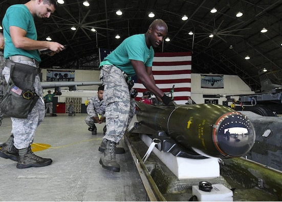 U.S. Air Force Senior Airman Michael Smith, 25th Aircraft Maintenance Unit 3-man, prepares to load a missile onto an A-10 Thunderbolt II during a quarterly 51st Maintenance Group weapons load competition at Osan Air Base, Republic of Korea, July 7, 2017. Load crews who performed well in their monthly proficiency loads and quarterly evaluations were chosen to compete in the competition. (U.S. Air Force photo by Airman 1st Class Gwendalyn Smith)