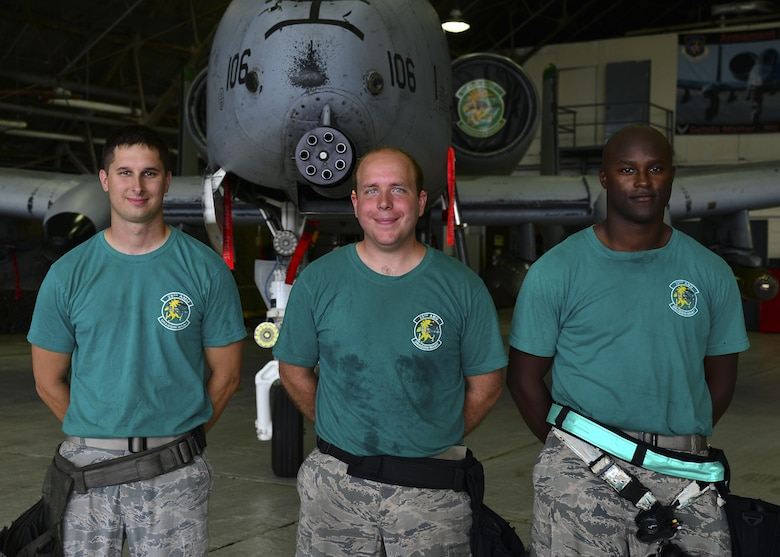 U.S. Air Force Staff Sgt. Jason O'Malley, Senior Airman David Hosler and Michael Smith, 25th Aircraft Maintenance Unit weapons load crew members, pose in front of an A-10 Thunderbolt II at Osan Air Base, Republic of Korea, July 7, 2017. Both teams were required to re-generate the aircraft back to their pre-determined combat figuration status. (U.S. Air Force photo by Airman 1st Class Gwendalyn Smith)