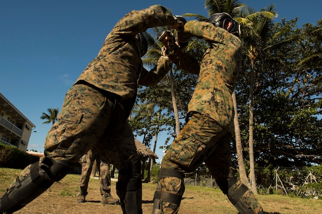 NOUMEA, NEW CALEDONIA— Sgt. Aaron Medlin, left, and Lance Cpl. Ryan Murray spar while participating in the French Nautical Commando Course during exercise Koa Moana, July 3, 2017, in Noumea, New Caledonia. Koa Moana 17 is designed to improve theater security, and conduct law enforcement and infantry training in the Pacific region in order to enhance interoperability with partner nations. Medlin is a rifleman with 3rd Battalion, 4th Marine Regiment, currently deployed to Koa Moana 17, and a Monroe, North Carolina, native. Murray is a rifleman with 3rd Battalion, 4th Marine Regiment, and a Sevierville, Tennessee, native. (U.S. Marine Corps Photo by Sgt. Douglas D. Simons)
