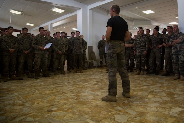 Capt. Roch Sardin, commanding officer of the Centre D'instruction Nautique, front, gives closing remarks after Marines and Sailors with 3rd Battalion, 4th Marine Regiment, participated in the French Nautical Commando Course during exercise Koa Moana 17, July 3, 2017, in Noumea, New Caledonia. Koa Moana 17 is designed to improve theater security, and conduct law enforcement and infantry training in the Pacific region in order to enhance interoperability with partner nations. (U.S. Marine Corps Photo by Sgt. Douglas D. Simons)