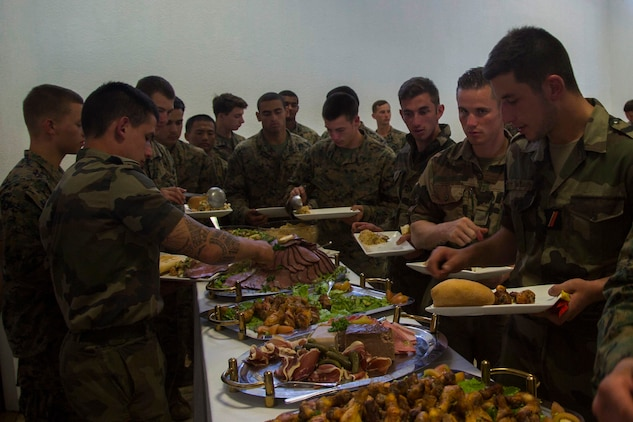 Marines and Sailors with 3rd Battalion, 4th Marine Regiment, currently deployed to Koa Moana 17, and French army soldiers grab food after participating in the French Nautical Commando Course during exercise Koa Moana 17, June 3, 2017, in Noumea, New Caledonia. Koa Moana 17 is designed to improve theater security, and conduct law enforcement and infantry training in the Pacific region in order to enhance interoperability with partner nations. (U.S. Marine Corps Photo by Sgt. Douglas D. Simons)