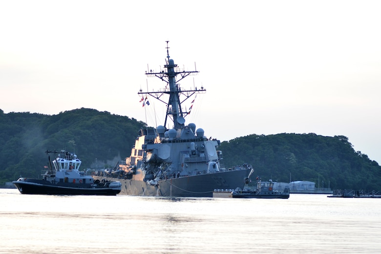 The U.S. Navy Arleigh Burke-class guided-missile destroyer USS Fitzgerald (DDG 62) returns to Fleet Activities Yokosuka following a collision with a merchant vessel while operating southwest of Yokosuka, Japan, June 17, 2017.