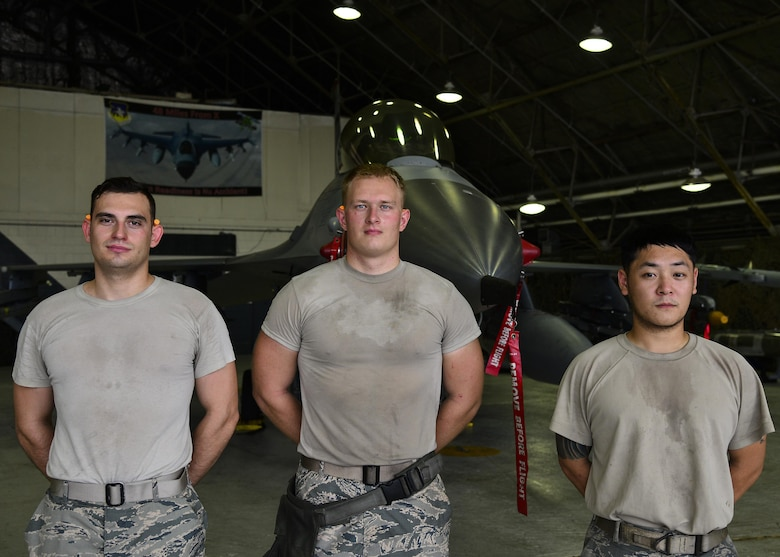U.S. Air Force Staff Sgt. Sung Kim, Airman 1st Class Daniel Namowicz and Senior Airman Ventsislav Ivanov, 36th Aircraft Maintenance Unit weapons load crew members, pose in front of an F-16 Fighting Falcon at Osan Air Base, Republic of Korea, July 7, 2017. Both teams were required to re-generate the aircraft back to their pre-determined combat figuration status. (U.S. Air Force photo by Airman 1st Class Gwendalyn Smith)