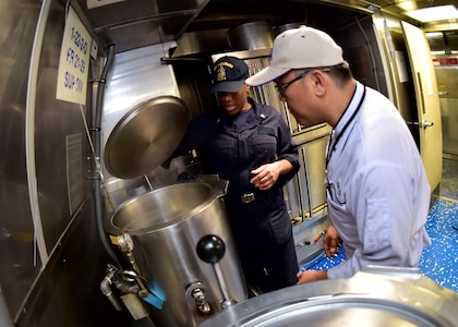 170601-N-QV906-026 SATTAHIP NAVAL BASE, Thailand (June 1, 2017) Culinary Specialist 2nd Class Shaneka Goode consults with a local chef during a Culinary Subject Matter Expert Exchange aboard USS Coronado (LCS 4) during Cooperation Afloat Readiness and Training Thailand 2017 June 1.  Cooperation Afloat Readiness and Training (CARAT) is a series of PACOM sponsored, U.S. Pacific Fleet led bilateral exercises held annually in South and Southeast Asia to strengthen relationships and enhance force readiness. CARAT exercise events cover a broad range of naval skill areas and disciplines including surface, undersea, air and amphibious warfare; maritime security operations; riverine, jungle and explosive ordnance disposal operations; combat construction; diving and salvage; search and rescue; maritime patrol and reconnaissance aviation; maritime domain awareness; military law, public affairs and military medicine; and humanitarian assistance, disaster response. (U.S. Navy photo by Mass Communication Specialist 1st Class Micah Blechner/RELEASED)
