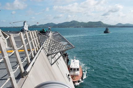 170602-N-PD309-004 GULF OF THAILAND (June 2, 2017) Sailors help a pilot depart the ship during sea and anchor detail aboard littoral combat ship USS Coronado (LCS 4) during Cooperation Afloat Readiness and Training (CARAT) Thailand. CARAT is a series of Pacific Command-sponsored, U.S Pacific Fleet-led bilateral exercises held annually in South and Southeast Asia to strengthen relationships and enhance force readiness. CARAT exercise events cover a broad range of naval skill areas and disciplines including surface, undersea, air, and amphibious warfare; maritime security operations; riverine, jungle, and explosive ordnance disposal operations; combat construction; diving and salvage; search and rescue; maritime patrol and reconnaissance aviation; maritime domain awareness; military law, public affairs and military medicine; and humanitarian assistance and disaster response. (U.S. Navy photo by Mass Communication Specialist 3rd Class Deven Leigh Ellis/Released)