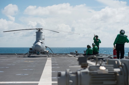 """170602-N-PD309-023 GULF OF THAILAND (June 2, 2017) Sailors assigned to the """"Wildcards"""" of Helicopter Sea Combat Squadron 23 prepare the MQ-8B Firescout unmanned aerial vehicle for launch aboard littoral combat ship USS Coronado (LCS 4) during Cooperation Afloat Readiness and Training (CARAT) Thailand. CARAT is a series of Pacific Command-sponsored, U.S Pacific Fleet-led bilateral exercises held annually in South and Southeast Asia to strengthen relationships and enhance force readiness. CARAT exercise events cover a broad range of naval skill areas and disciplines including surface, undersea, air, and amphibious warfare; maritime security operations; riverine, jungle, and explosive ordnance disposal operations; combat construction; diving and salvage; search and rescue; maritime patrol and reconnaissance aviation; maritime domain awareness; military law, public affairs and military medicine; and humanitarian assistance and disaster response. (U.S. Navy photo by Mass Communication Specialist 3rd Class Deven Leigh Ellis/Released)"""