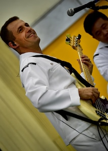 170602-N-QV906-034 PATTAYA, Thailand (June 2, 2017) Navy Musician 2nd Class Mark Lame, of the U.S. 7th Fleet Band, Orient Express, jams out during a performance at Pattaya City No. 8 School as part of Cooperation Afloat Readiness and Training Thailand 2017 in Pattaya, Thailand, June 2. Cooperation Afloat Readiness and Training (CARAT) is a series of PACOM sponsored, U.S. Pacific Fleet led bilateral exercises held annually in South and Southeast Asia to strengthen relationships and enhance force readiness. CARAT exercise events cover a broad range of naval skill areas and disciplines including surface, undersea, air and amphibious warfare; maritime security operations; riverine, jungle and explosive ordnance disposal operations; combat construction; diving and salvage; search and rescue; maritime patrol and reconnaissance aviation; maritime domain awareness; military law, public affairs and military medicine; and humanitarian assistance, disaster response. (U.S. Navy photo by Mass Communication Specialist 1st Class Micah Blechner/RELEASED)