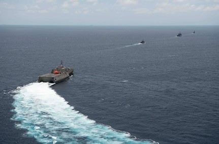 """170603-N-PD309-807 GULF OF THAILAND (June 3, 2017) Littoral combat ship USS Coronado (LCS 4) sails behind Royal Thai Navy ships carrying a """"killer tomato""""target before a gunnery exercise during Cooperation Afloat Readiness and Training (CARAT) Thailand. CARAT is a series of Pacific Command-sponsored, U.S Pacific Fleet-led bilateral exercises held annually in South and Southeast Asia to strengthen relationships and enhance force readiness. CARAT exercise events cover a broad range of naval skill areas and disciplines including surface, undersea, air, and amphibious warfare; maritime security operations; riverine, jungle, and explosive ordnance disposal operations; combat construction; diving and salvage; search and rescue; maritime patrol and reconnaissance aviation; maritime domain awareness; military law, public affairs and military medicine; and humanitarian assistance and disaster response. (U.S. Navy photo by Mass Communication Specialist 3rd Class Deven Leigh Ellis/Released)"""