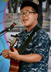 170603-N-QV906-028 CHONBURI, Thailand (June 3, 2017) Navy Musician 2nd Class Daniel Park, of the U.S. 7th Fleet Band, Orient Express, performs at the Child Protection and Development Center in Chonburi, Thailand, while participating in Cooperation Afloat Readiness and Training Thailand 2017 June 3.  Cooperation Afloat Readiness and Training (CARAT) is a series of PACOM sponsored, U.S. Pacific Fleet led bilateral exercises held annually in South and Southeast Asia to strengthen relationships and enhance force readiness. CARAT exercise events cover a broad range of naval skill areas and disciplines including surface, undersea, air and amphibious warfare; maritime security operations; riverine, jungle and explosive ordnance disposal operations; combat construction; diving and salvage; search and rescue; maritime patrol and reconnaissance aviation; maritime domain awareness; military law, public affairs and military medicine; and humanitarian assistance, disaster response. (U.S. Navy photo by Mass Communication Specialist 1st Class Micah Blechner/RELEASED)