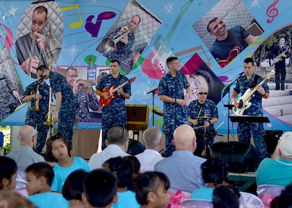 170603-N-QV906-034 CHONBURI, Thailand (June 3, 2017) The U.S. 7th Fleet Band, Orient Express, perform at the Child Protection and Development Center in Chonburi, Thailand, while participating in Cooperation Afloat Readiness and Training Thailand 2017 June 3.  Cooperation Afloat Readiness and Training (CARAT) is a series of PACOM sponsored, U.S. Pacific Fleet led bilateral exercises held annually in South and Southeast Asia to strengthen relationships and enhance force readiness. CARAT exercise events cover a broad range of naval skill areas and disciplines including surface, undersea, air and amphibious warfare; maritime security operations; riverine, jungle and explosive ordnance disposal operations; combat construction; diving and salvage; search and rescue; maritime patrol and reconnaissance aviation; maritime domain awareness; military law, public affairs and military medicine; and humanitarian assistance, disaster response. (U.S. Navy photo by Mass Communication Specialist 1st Class Micah Blechner/RELEASED)