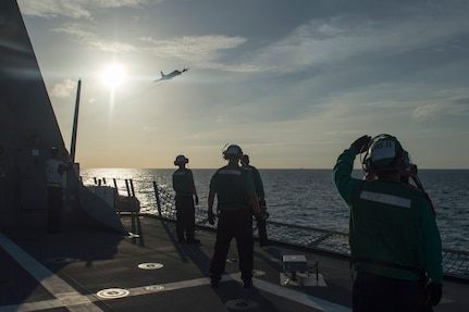 170604-N-PD309-051 GULF OF THAILAND (June 4, 2017) Sailors aboard littoral combat ship USS Coronado (LCS 4) watch a P-3 Orion fly overhead anti-submarine warfare training during Cooperation Afloat Readiness and Training (CARAT) Thailand. CARAT is a series of Pacific Command-sponsored, U.S Pacific Fleet-led bilateral exercises held annually in South and Southeast Asia to strengthen relationships and enhance force readiness. CARAT exercise events cover a broad range of naval skill areas and disciplines including surface, undersea, air, and amphibious warfare; maritime security operations; riverine, jungle, and explosive ordnance disposal operations; combat construction; diving and salvage; search and rescue; maritime patrol and reconnaissance aviation; maritime domain awareness; military law, public affairs and military medicine; and humanitarian assistance and disaster response. (U.S. Navy photo by Mass Communication Specialist 3rd Class Deven Leigh Ellis/Released)